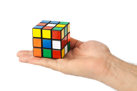 Cube puzzle in hand isolated on white background