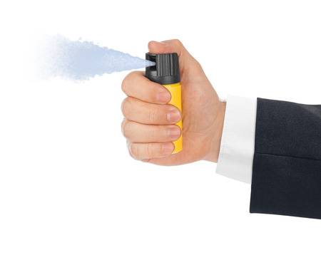 oleoresin: Hand with bottle of pepper spray isolated on white background Stock Photo