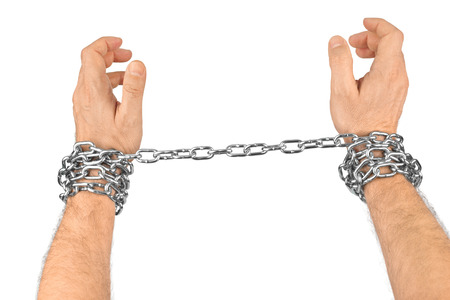 manacles: Hands and chain isolated on white background