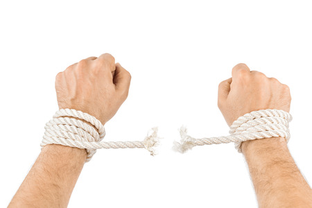 breaking: Hands and breaking rope isolated on white background
