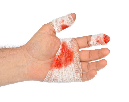 injured person: Hand with blood and bandage isolated on white background Stock Photo