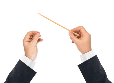baton: Music conductor hands isolated on white background Stock Photo