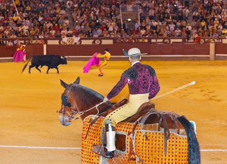 capote: Matador and bull in corrida at Madrid Spain Editorial