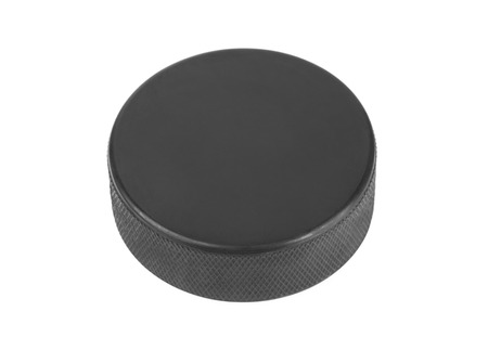 hockey skates: Ice hockey puck isolated on white background Stock Photo