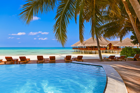 maldives island: Pool and cafe on Maldives beach - nature vacation background