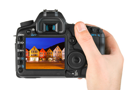 photographing: Hand with camera and Norway travel photo isolated on white background