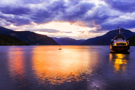 hardanger: Ferry in fjord Hardanger Norway - nature and travel background Stock Photo