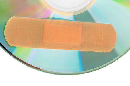 disaster recovery: CD with software patch isolated on white background Stock Photo