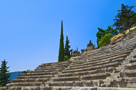 archaeology: Ruins of amphitheater in Delphi, Greece - archaeology background