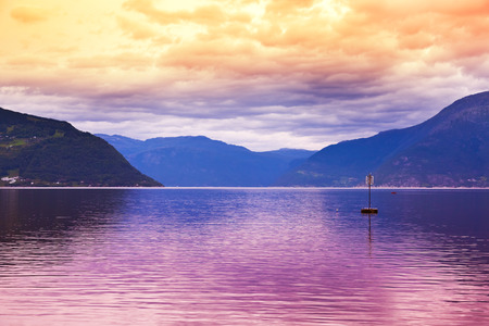 hardanger: Sunset in fjord Hardanger Norway - nature and travel background