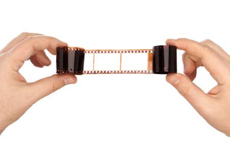 rollo pelicula: Películas fotográficas en las manos aisladas en fondo blanco Foto de archivo