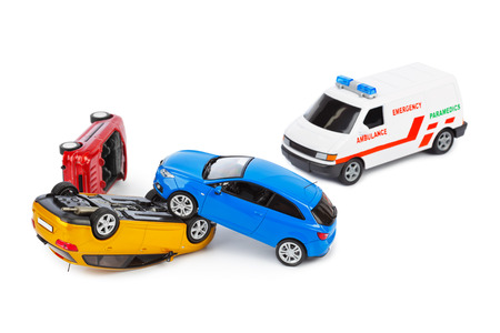 car wreck: Crash toy cars and ambulance car isolated on white background Stock Photo