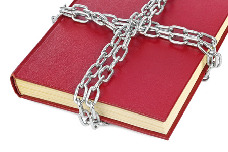 protection of the bible: Book and chain isolated on white background