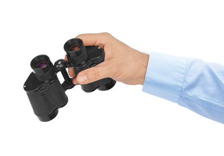 Hand with binoculars isolated on white background photo