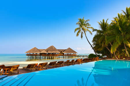 bungalows: Pool on tropical Maldives island - nature travel background Stock Photo