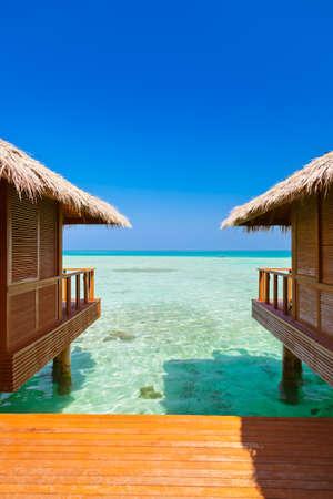 palapa: Water bungalows on tropical Maldives island - nature travel background