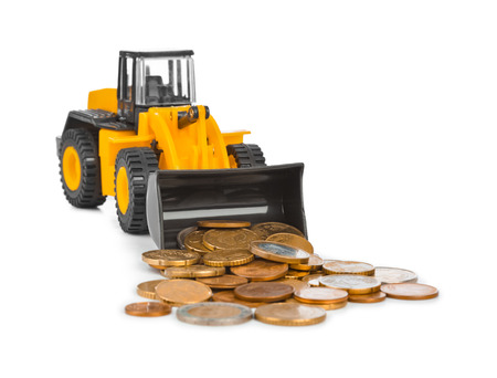 gold shovel: Toy loader and money coins isolated on white background