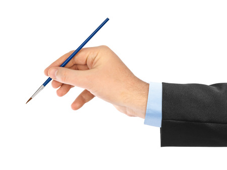 brocha de pintura: Mano con pincel aisladas sobre fondo blanco