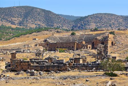 pamukkale: Amphitheater ruins at Pamukkale Turkey - architecture background Stock Photo
