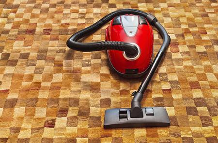 housework: Vacuum cleaner on carpet - technology housework Stock Photo