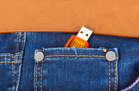 flashes: USB flash memory in jeans pocket - technology background