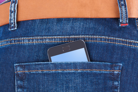 pocket pc: Jeans and mobile phone isolated on white background