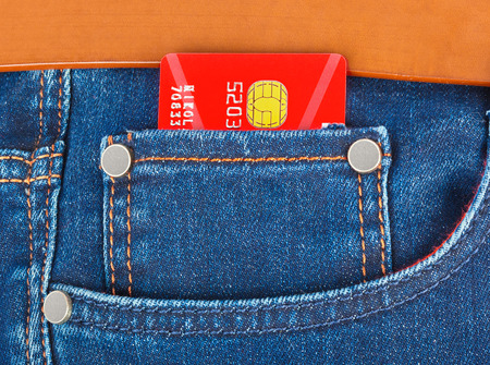 bancomat: Credit card in jeans pocket - shopping background Stock Photo