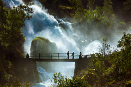 waterfall with sky: Waterfall near Briksdal glacier - Norway - nature and travel background Stock Photo