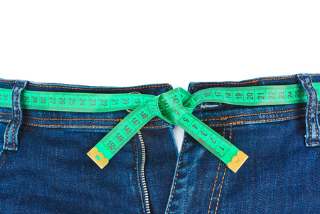 women sport: Jeans and measuring tape - slimming concept - isolated on white background Stock Photo