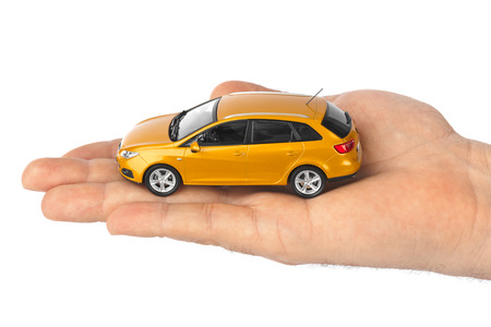 hatchback: Hand with car isolated on white background