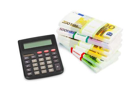 money background: Calculator and money isolated on white background