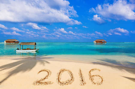 boat dock: Numbers 2016 on beach - concept holiday background