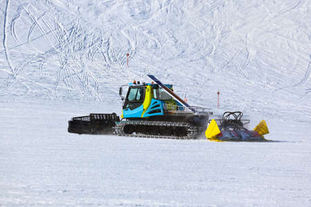 snow grooming machine: Snowplow at Mountains ski resort Innsbruck Austria - nature and sport background
