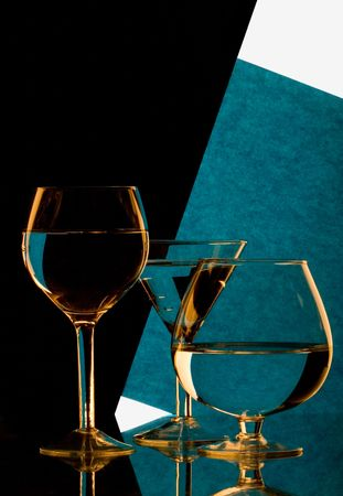 Glass on a background black and dark blue Stock Photo