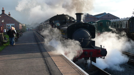 buffers: Steam train pulling into Brownhills Railway Station on winters day Editorial