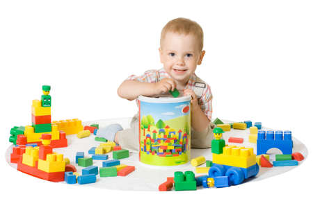 little boy playing with colorful blocks. White isolated photo