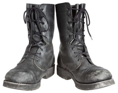 combat boots: used military boots isolated on white background