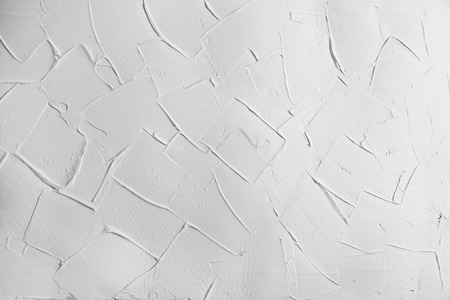 putty: white wall stucco plaster texture, background with right angles  Stock Photo