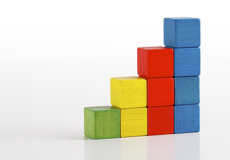 Toys blocks as step stair, multicolor wooden ladder building bricks over white   Stock Photo