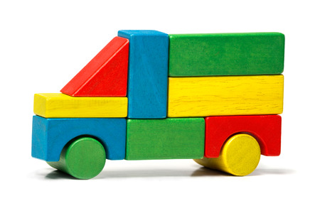 toy truck, multicolor car wooden blocks, transport over white  photo