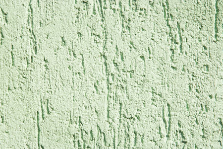 scuffed: stucco texture, rough ragged plaster background, scratched cracked wall Stock Photo