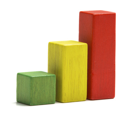 Toys wooden blocks as increasing graph bar, infographic diagram, chart over white background photo