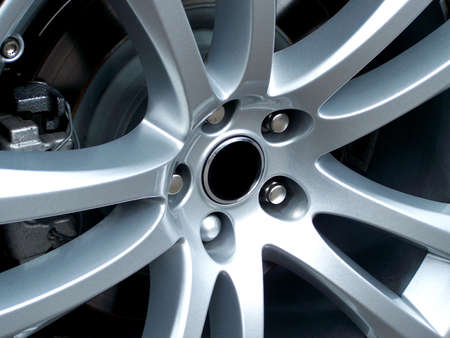 silver alloy: A close up photo of a sports car alloy wheel. Perfect for sports concept designs.