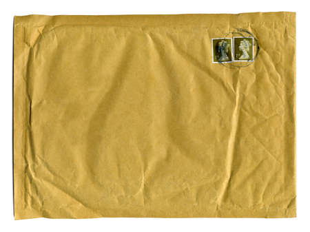 Large brown envelope with first class stamps and clear space for text