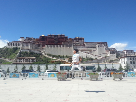 potala: jumping in front Potala, Tibet.