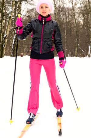 young woman skiing photo