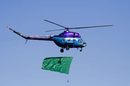 gaily: Mi-2 small helicopter gaily coloured with empty transparency Stock Photo