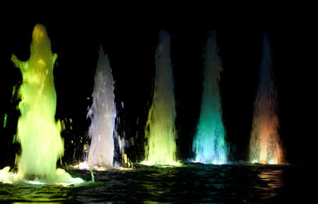 fountain with colored water streams  Stock Photo