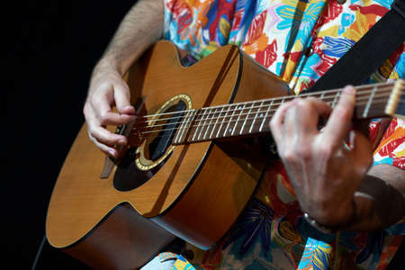 grasping: acoustic guitar in man hands Stock Photo