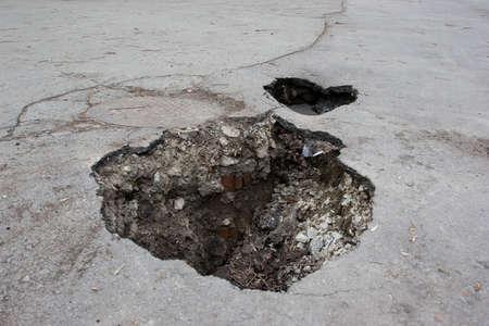 hole in asphalt road